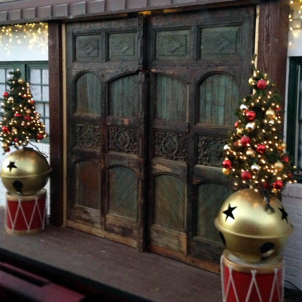 Large Old fashion wood doors to Santa's Workshop at the North Pole Experience