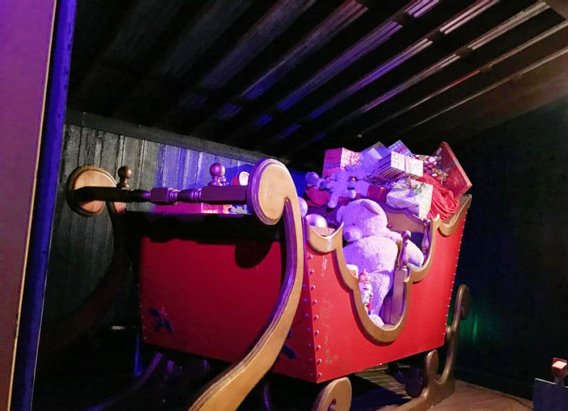 Santa's red sleigh filled with toys