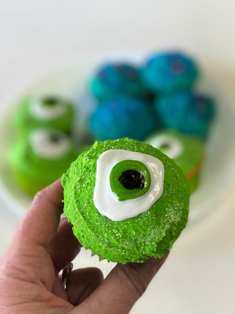 green frosted cupcake with giant green eye