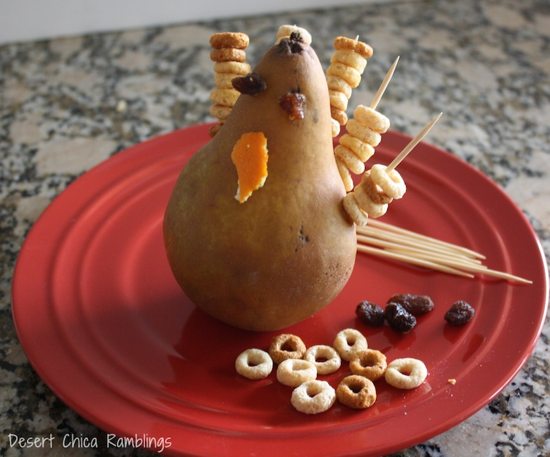 Keep the kids busy this Thanksgiving before the meal with a turkey pear craft - if they get hungry it can be their appetizer too!