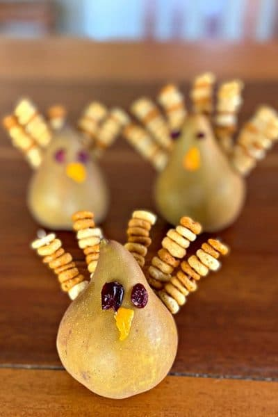Bosc pears decorated like Thanksgiving Turkeys