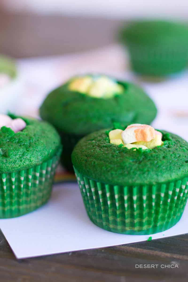 Lucky Charms cupcakes with marshmallows hidden in the center of green cupcakes are a fun and tricky St. Patrick's Day treat that even the leprechauns will appreciate