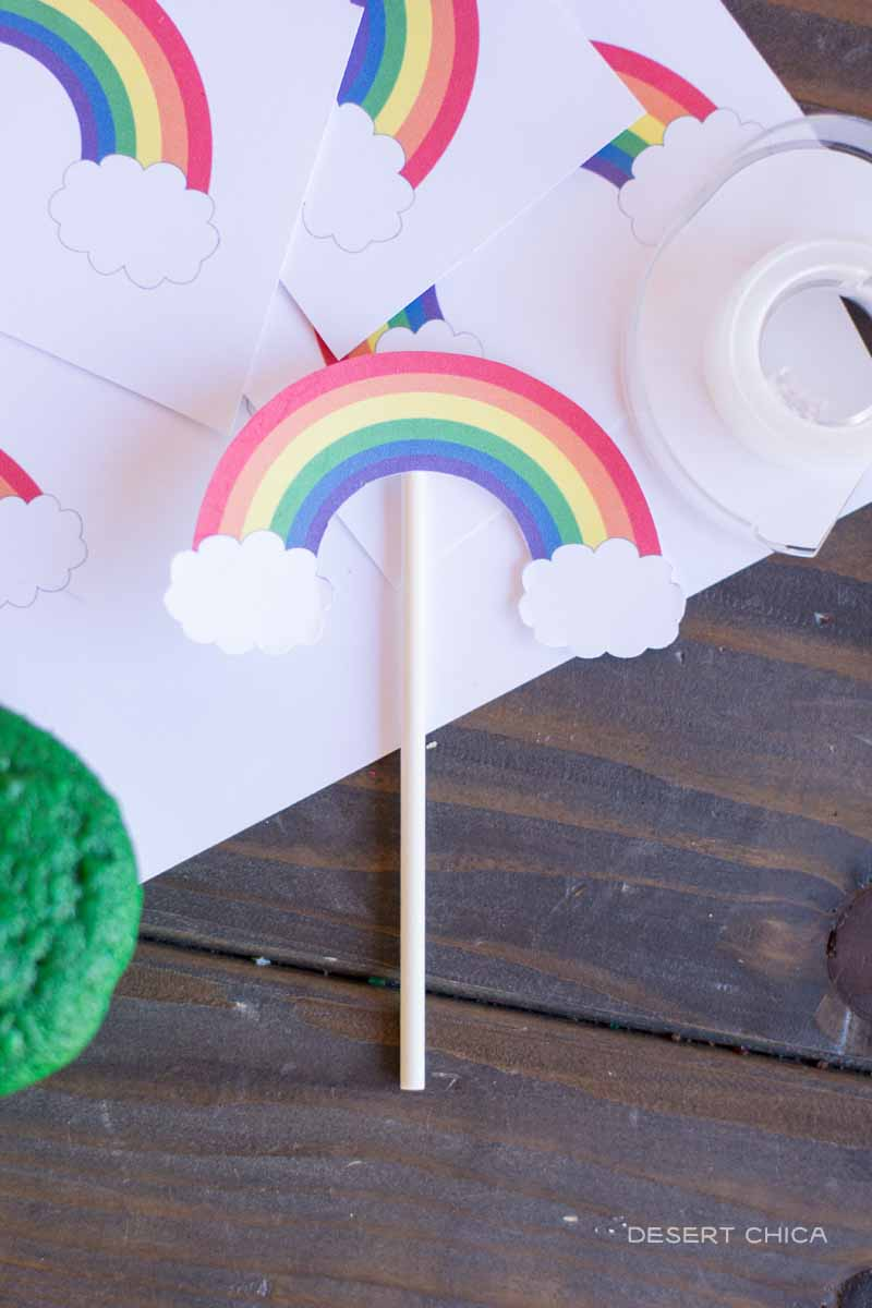 Print these free rainbow cupcake toppers to add a hint of whimsy to the St. Patrick's Day cupcake pinatas