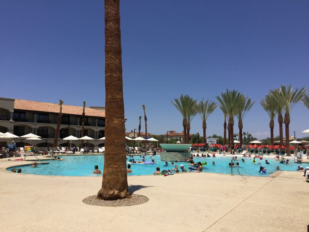 large pool with sandy beach in Scottsdale