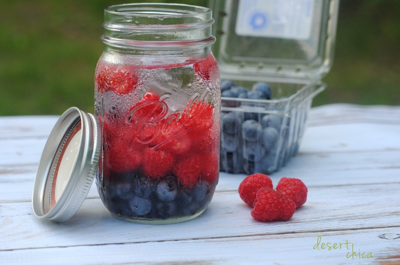 Blueberry and Raspberry infused water in a mason jar.jpg
