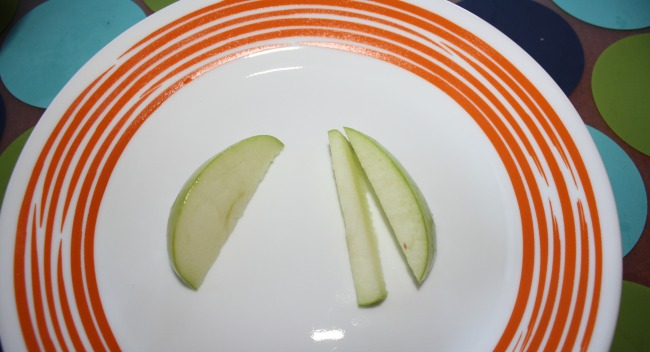 Cut apple slices off wedge to lay flat thanksgiving fruit turkey