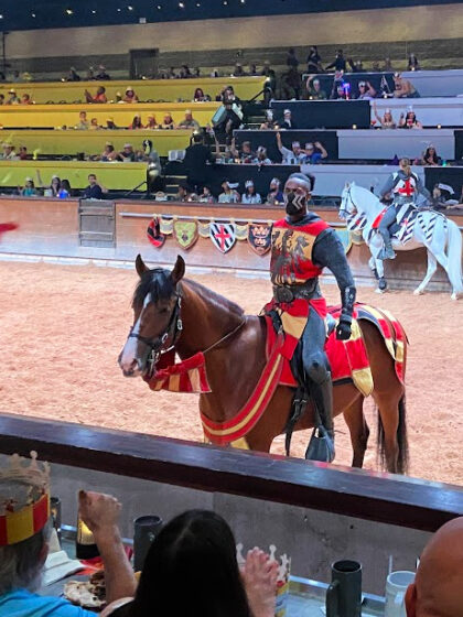 yellow and red knight on his horse at Medieval Times Scottsdale