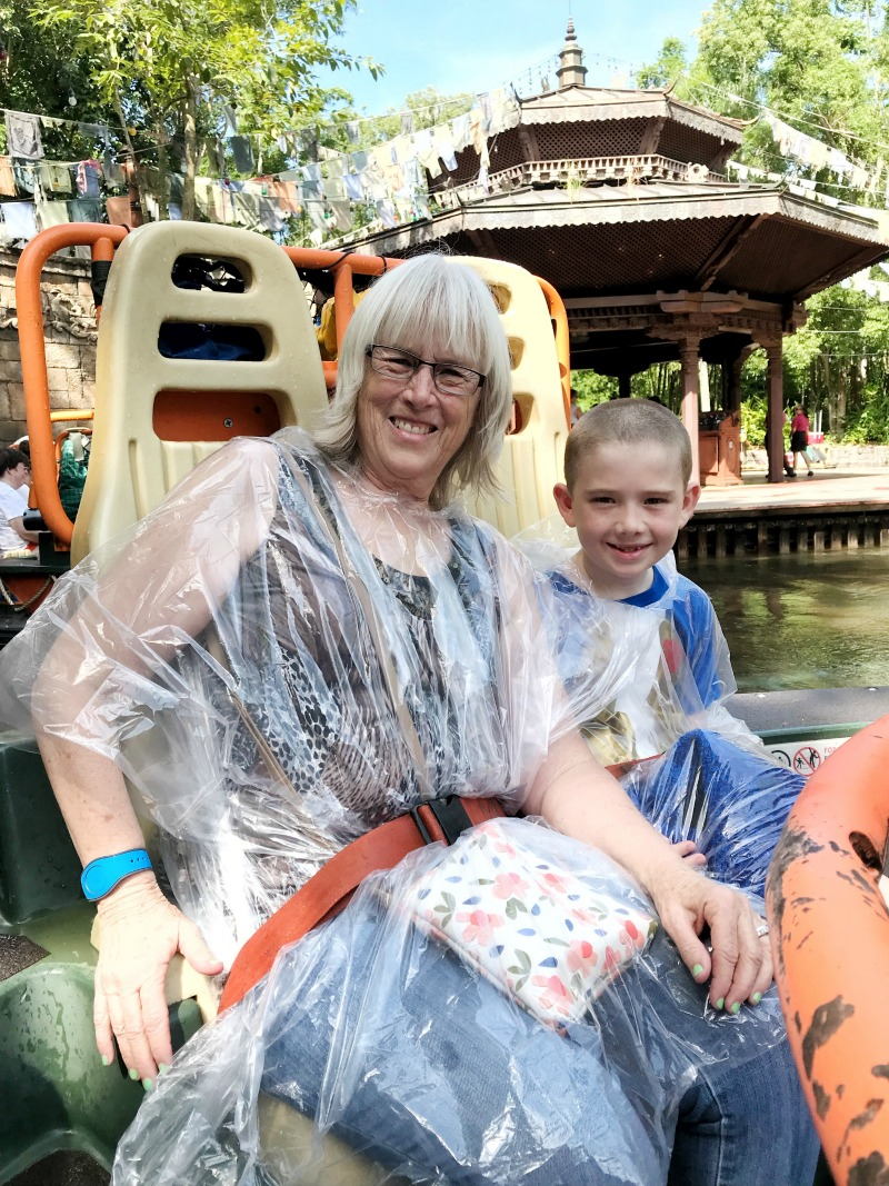 Things to bring on a disney trip include ponchos for rain and crazy water rides