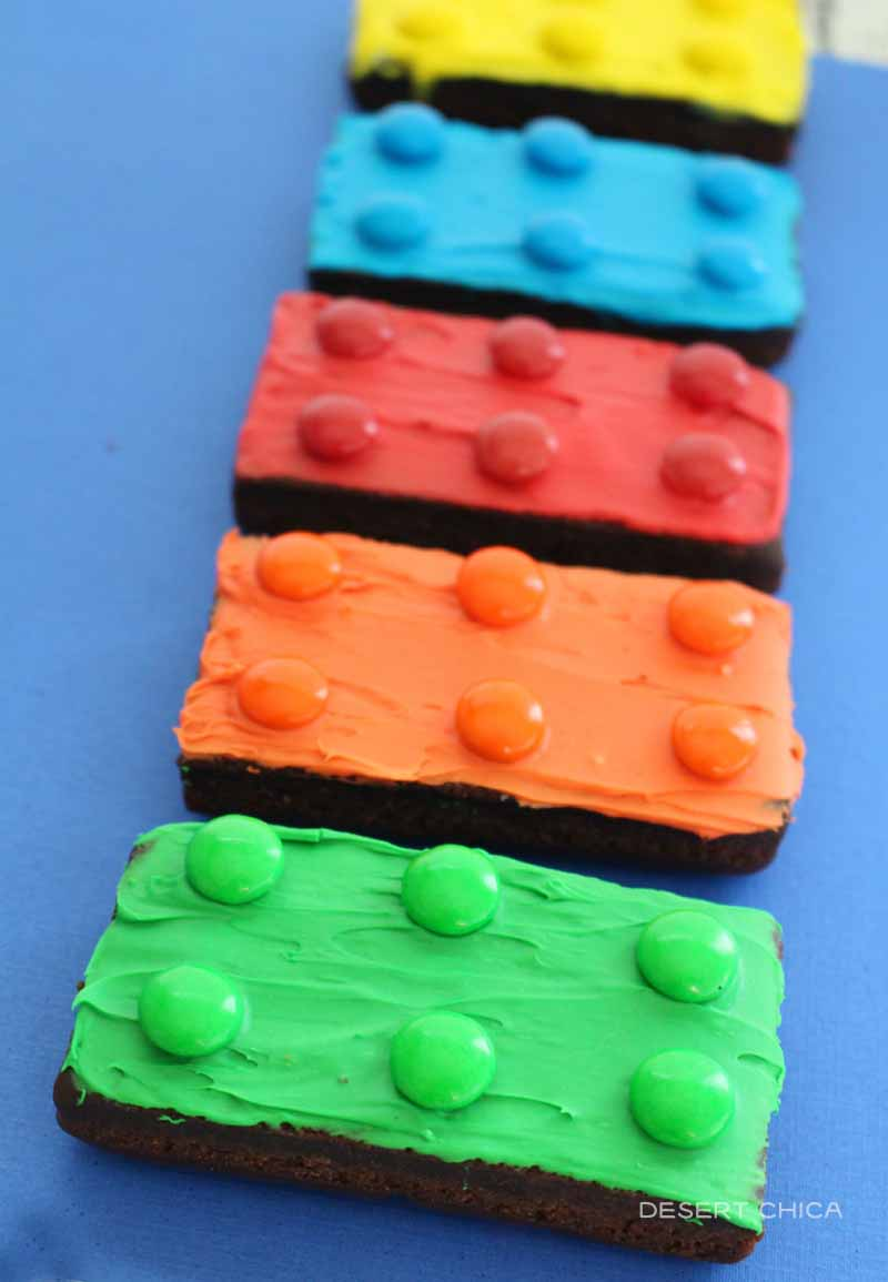 Rainbow of brownies decorated to look like LEGO bricks