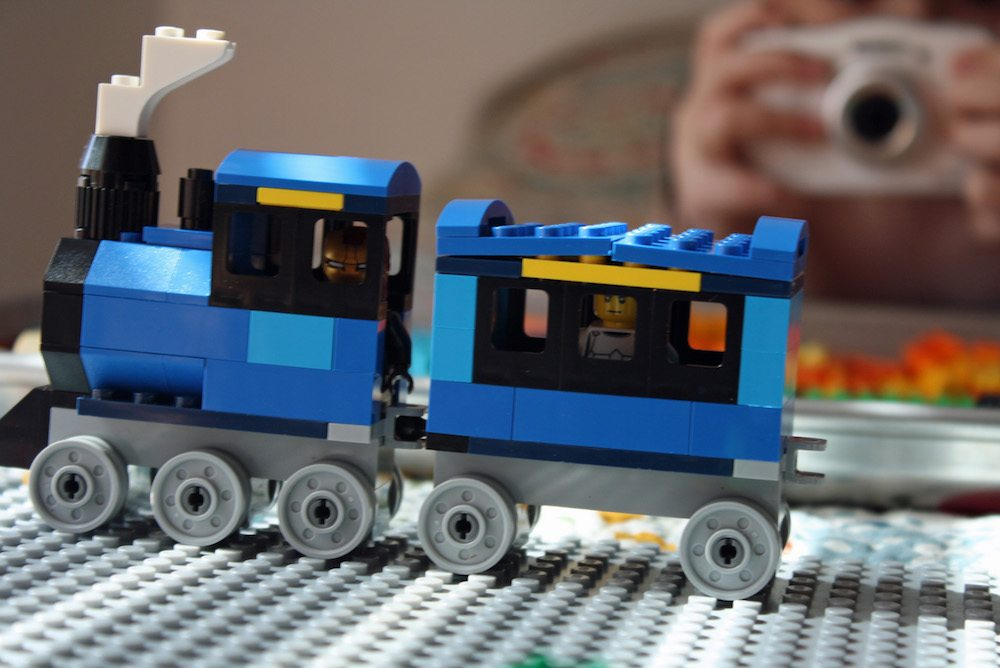 Ironman and Stormtrooper LEGO minifigure driving in LEGO train