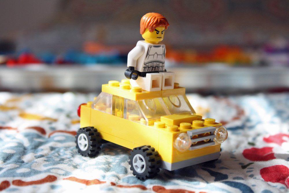 Stormtrooper Ninago LEGO Minifigure driving a taxi
