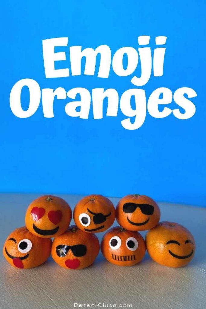 oranges decorated with emoji faces