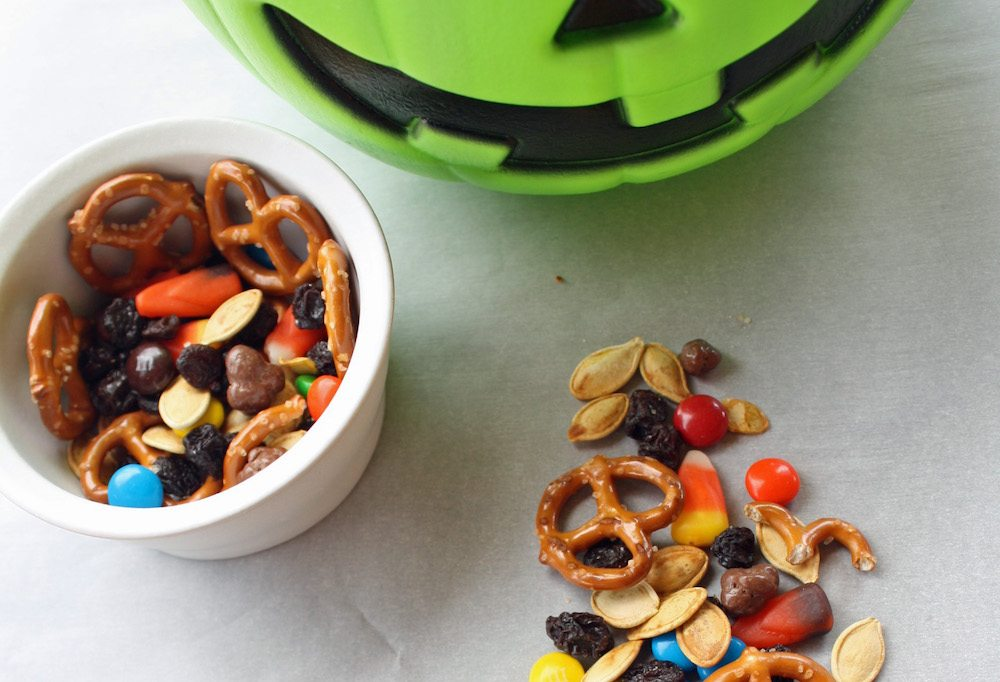 Do you have leftover candy from trick or treating and Halloween party snacks? How about mixing it up into a yummy after Halloween Trail Mix!