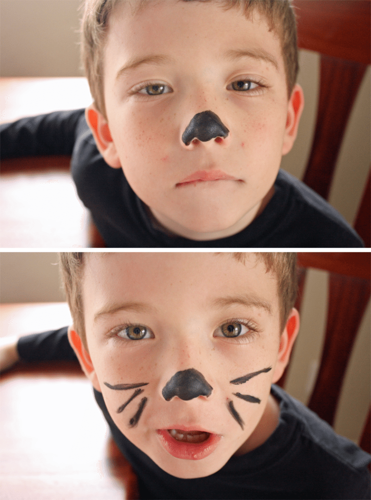 Black nose and whiskers painted on little boy face