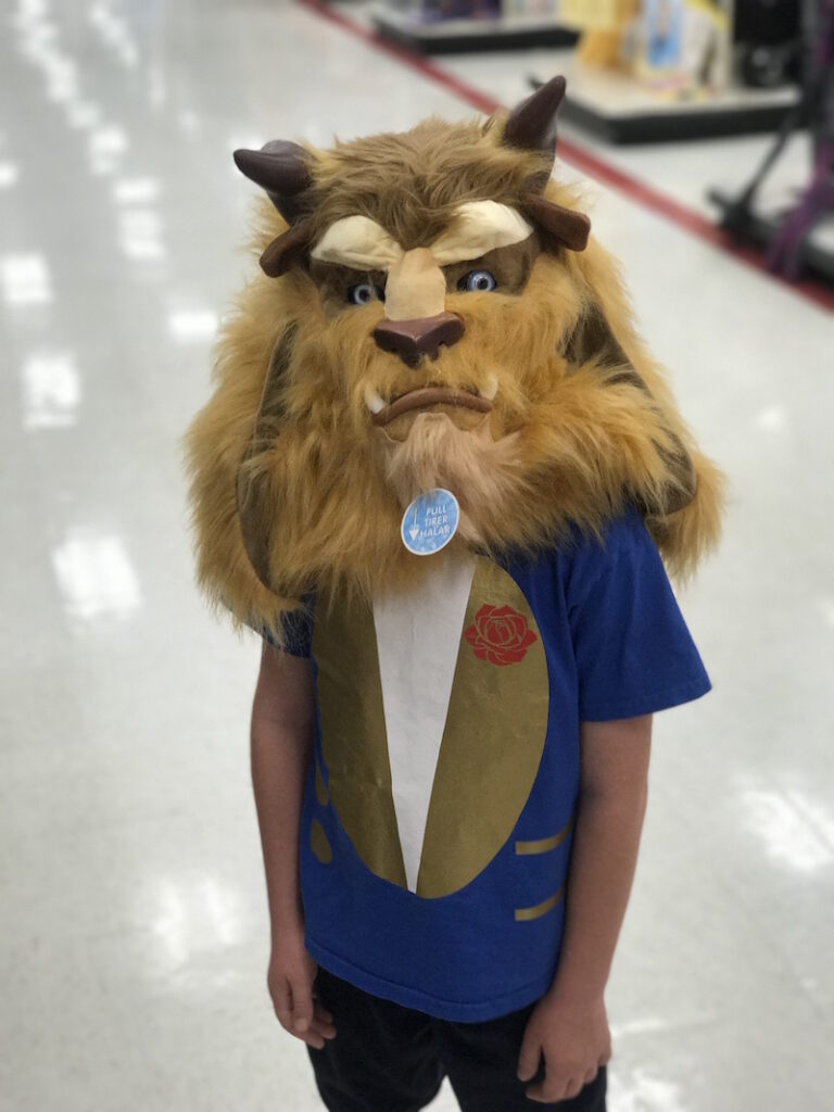 Kid wearing a beast costume mask and beauty and beast costume t-shirt