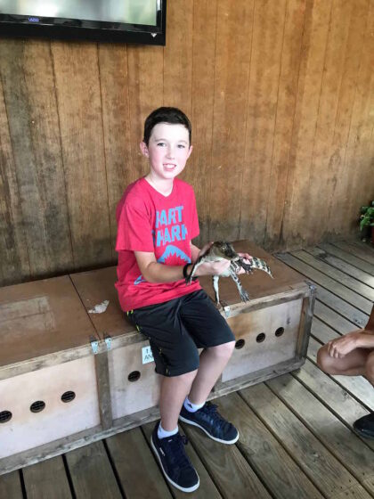Hold an alligator at crocodile encounter Mazda and more fun things to do near Houston with kids