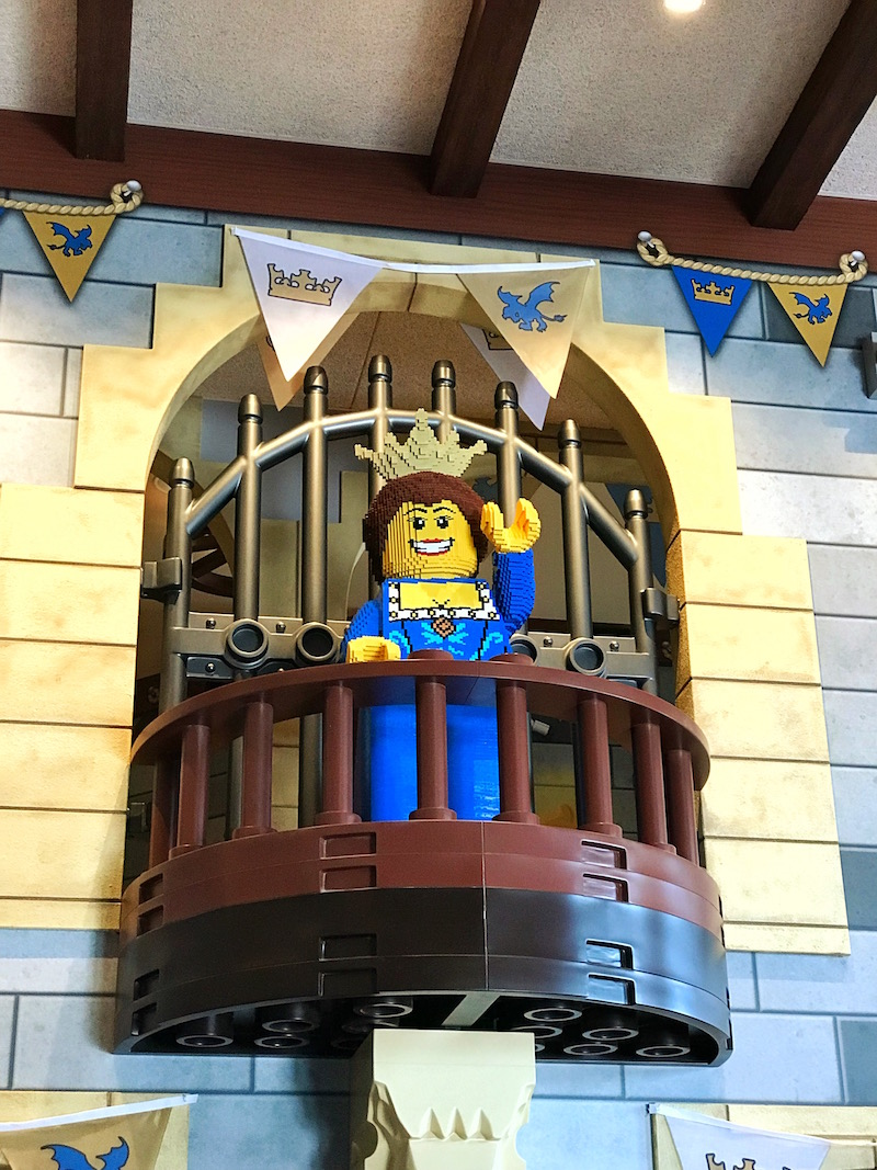 The Queen greets you in the LEGOLAND Castle Hotel Grand Hall (Lobby)