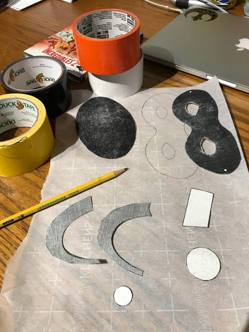 Use parchment paper to make cutting duct tape easier for Incredibles Pumpkins