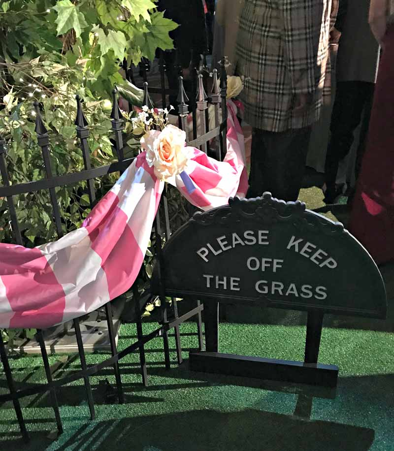 Please Keep Off the Grass sign at Mary Poppins Returns red carpet premiere party