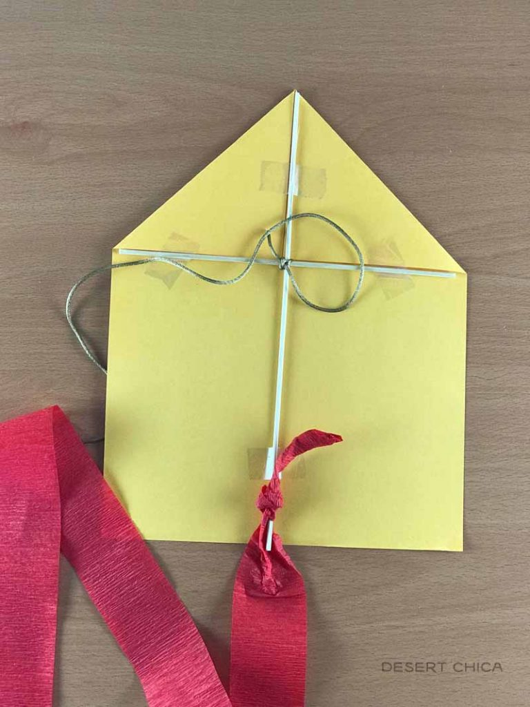 Tie on paper streamer to create a kite tail when making a Mary Poppins Paper Kite Craft