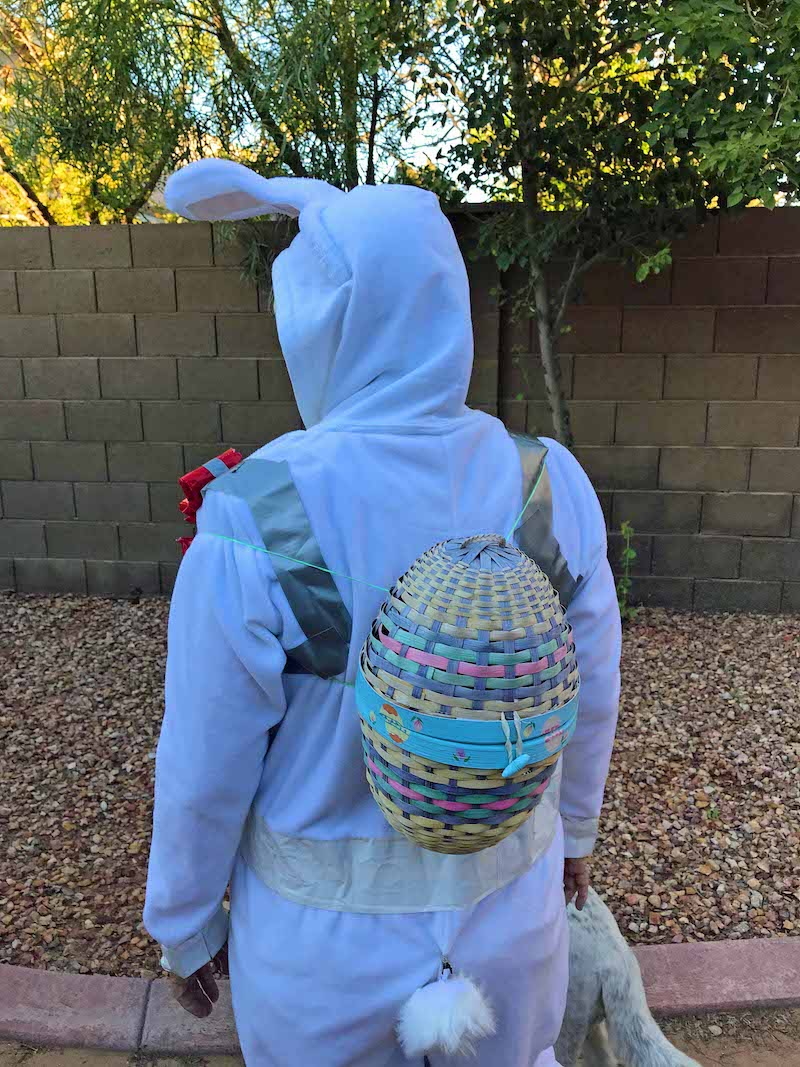back of white bunny suit with easter egg backpack