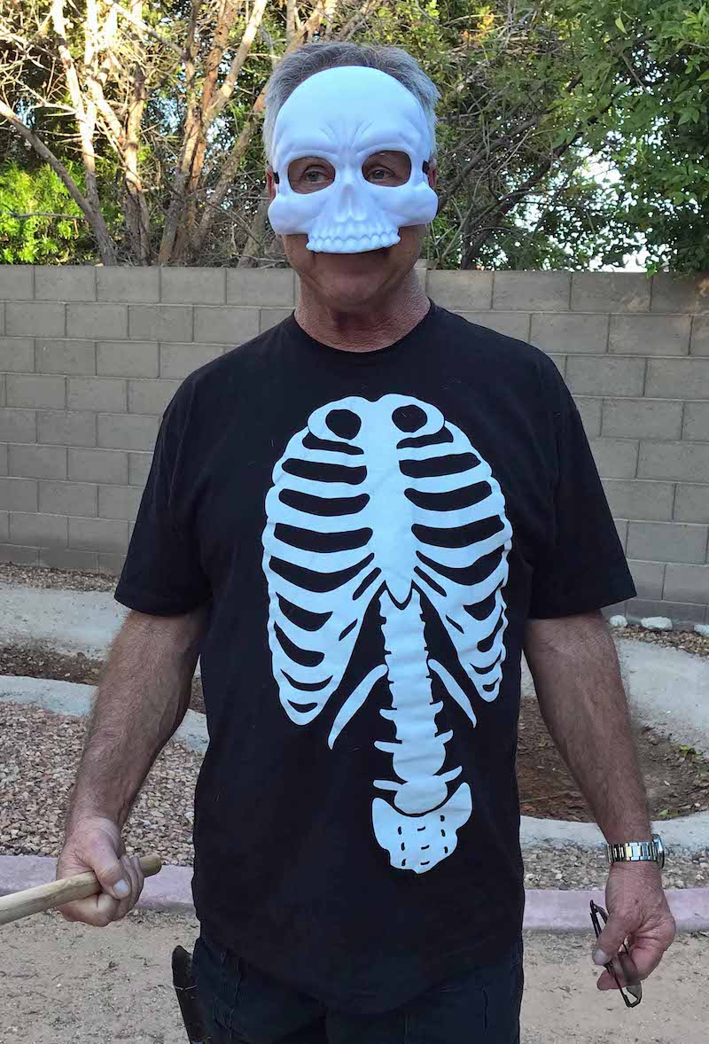 Man wearing skeleton t-shirt and mask