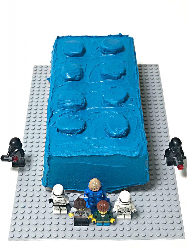 cake shaped like a blue LEGO brick