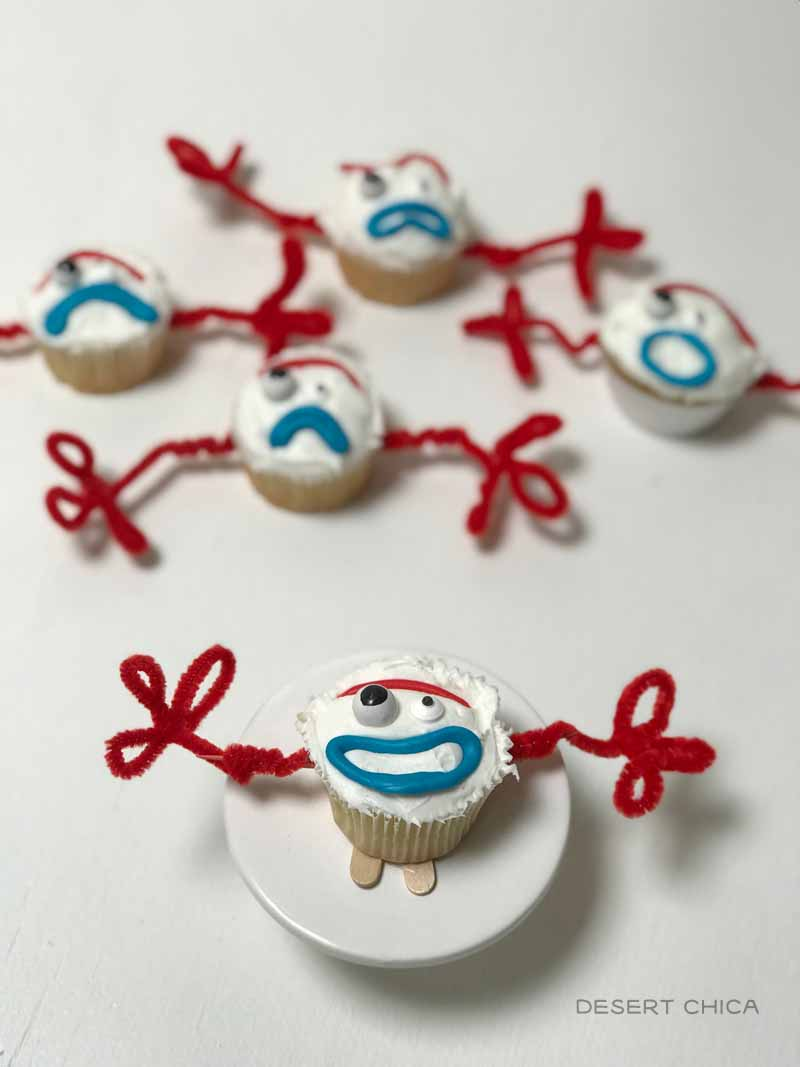 5 cupcakes designed to look like the character Forky from Toy Story 4
