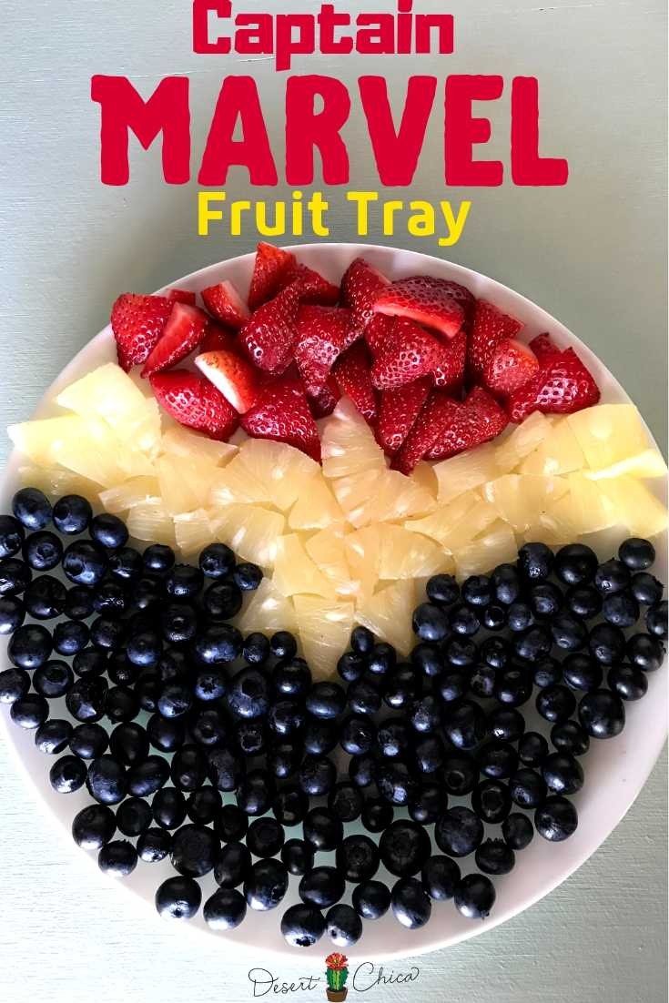 Fruit tray ceaturing strawberries, pineapple and blueberries