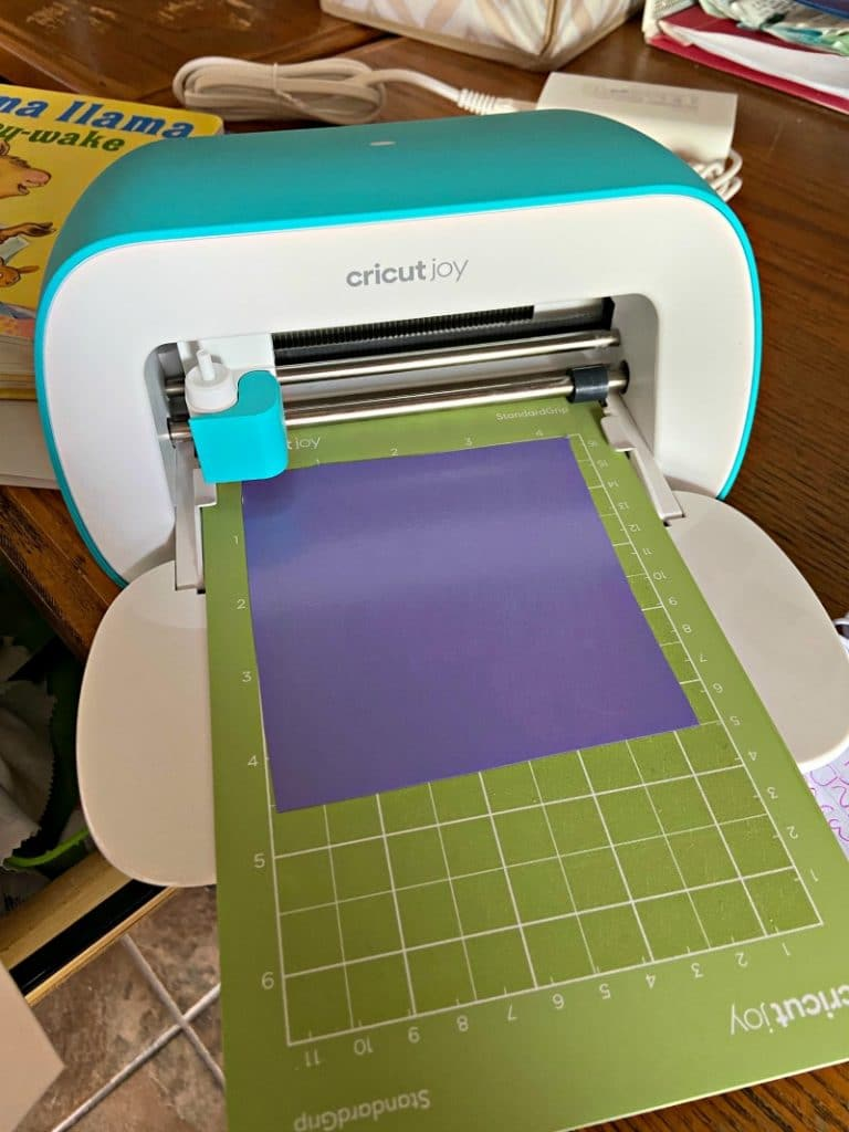 Cricut Joy machine with mat loaded