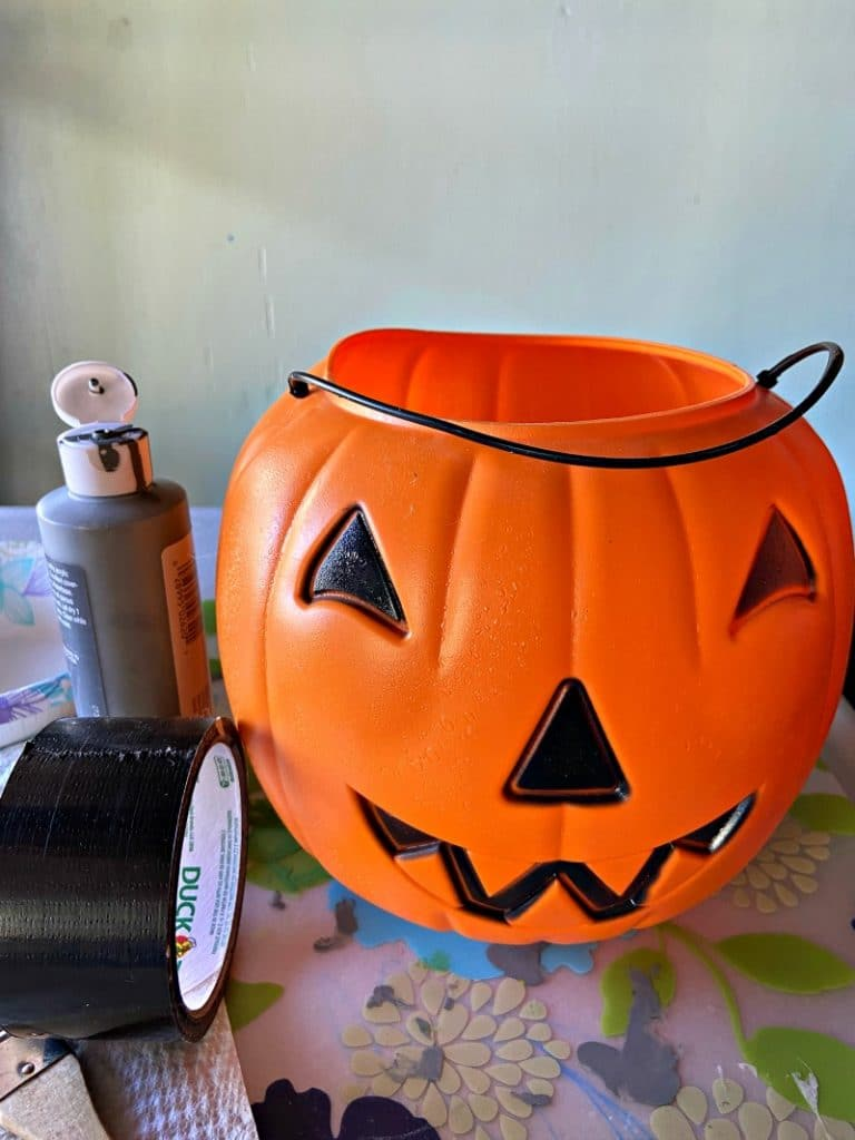 Orange pumpkin bucket with paint and duct tape