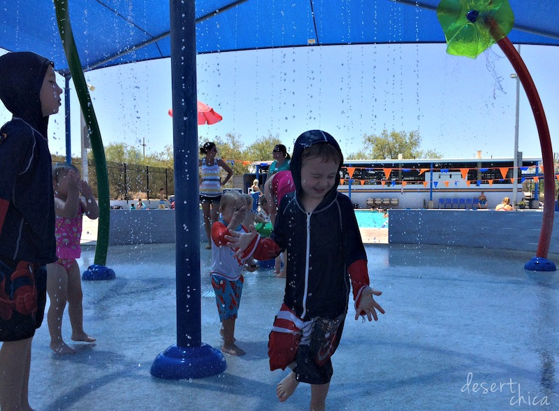 kid playing in shaded splash area