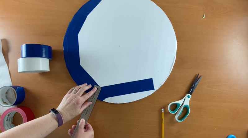 blue duct tape strips added around edge of white circle